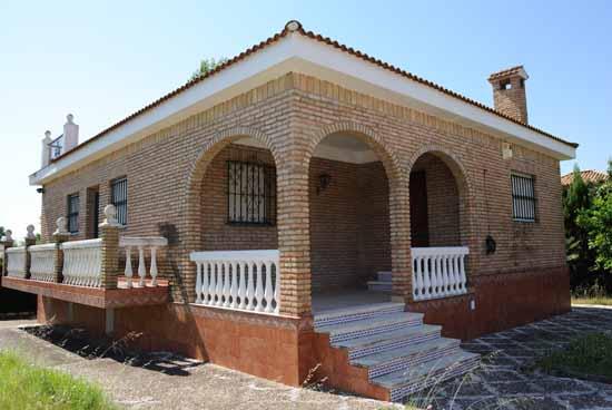 Casas de ladrillo rustico saln rstico con paredes de for Fachadas de ladrillo rustico